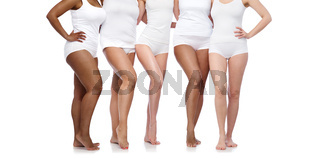 group of happy diverse women in white underwear