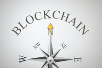 compass with the word blockchain