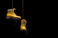Timberland boots yellow on a black background