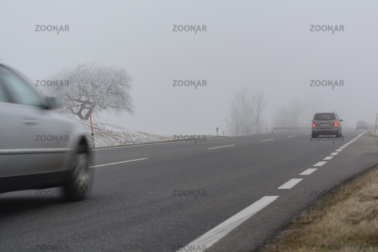 Cars are driving in bad weather in autumn