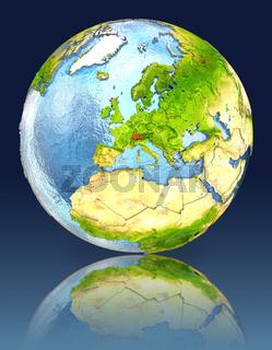 Switzerland on globe with reflection