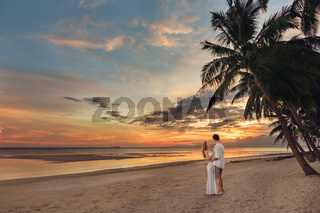 Young couple on the tropical beach