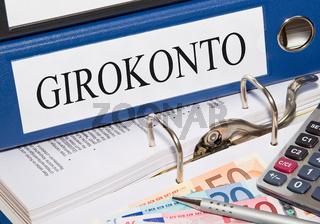 Girokonto Ordner mit Geld und Taschenrechner
