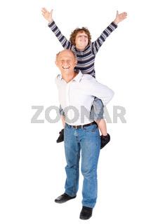 Grandfather giving grandson piggy-back