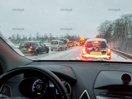 snowstorm, poor car driving on slick roads