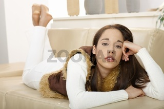 Portrait of woman on couch