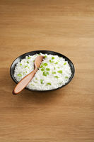 Basmati Rice with Coriander and Spoon on Wood Surface