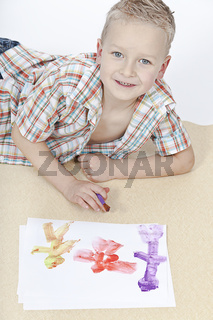 boy painting his family with colorful paints
