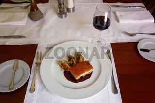 Traditional Peruvian Meal Called Chicharron de Panceta de Cerdo Served in a Restaurant