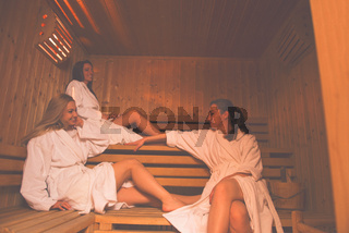 a group of young women in a sauna