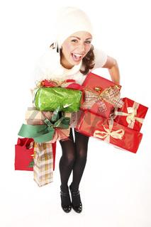 Joyful Beautiful Woman With Lots Of Christmas Presents