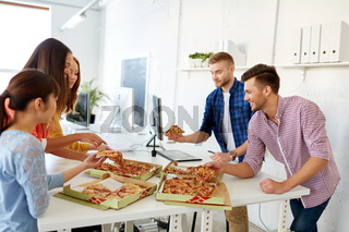 happy business team eating pizza at office