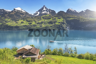 Swiss alps and mountain lake in spring