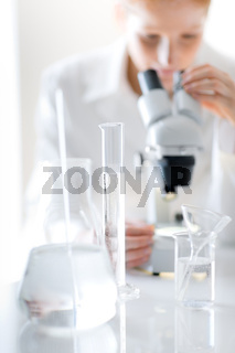 Microscope laboratory - woman medical research