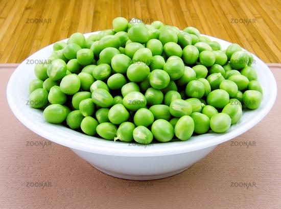 Fresh green peas on a plate
