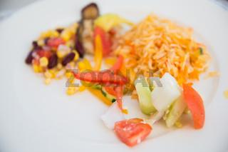 vegetable salad and garnish on plate