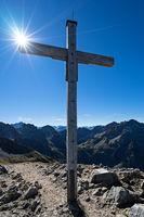 Summit cross Mt. Hammerspitze with sun
