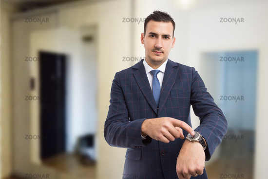 Realtor showing wristwatch as late for appointment gesture concept