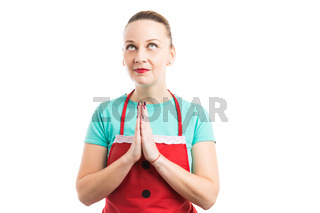 Cleaning lady or housekeeper praying