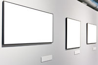 White wall in museum with three empty frames