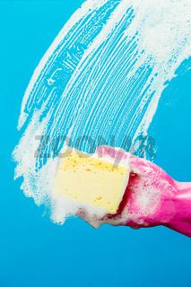 Man washes window with sponge