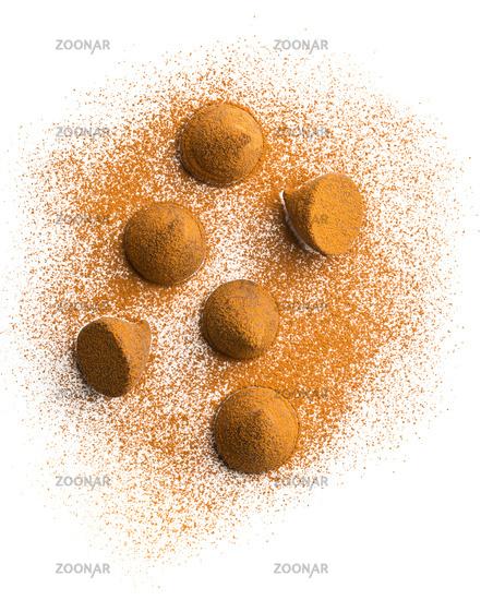 Sweet chocolate truffles and cocoa powder.