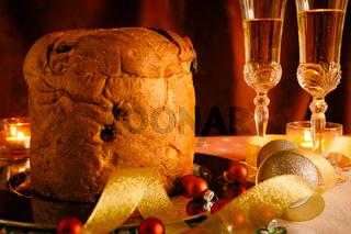Closeup of Christmas cake and sparkling wine