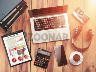 Office workplace. Wooden desk background with laptop, mobile phone, digital camera, calculator, business charts, coffee, binders and loudspeakers. Office workspace.