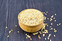 Flaxen white seed in bowl on dark board