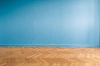 blue wall  in empty room  with parquet floor
