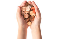 Child hands holding euro cent coins