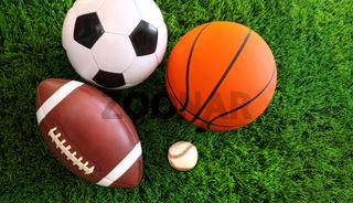 Assortment of sport balls on grass