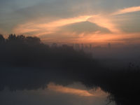 River at dawn with fog