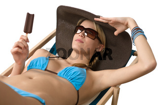 Beach - Attractive woman with hat and ice lolly