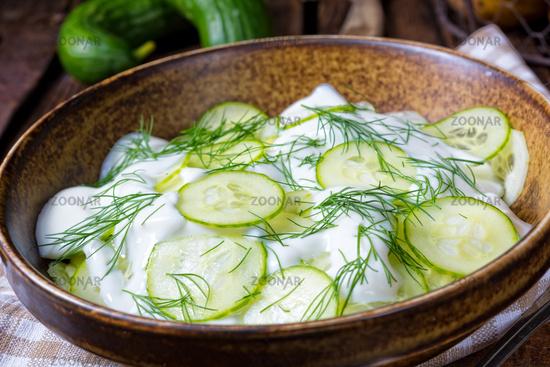 fresh cucumber salad with yogurt and young potatoes