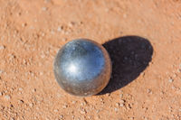 Petanque ball on the ground