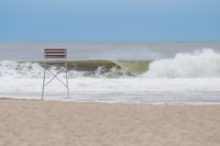 Big hurricane wave pounding at empty beach