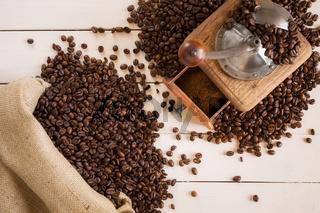 Bag of coffee and coffee grinder