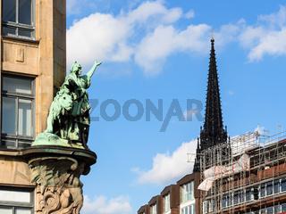 outdoor sculpture and steeple Church in Hamburg
