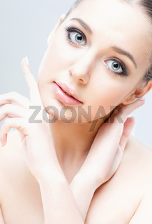close-up studio portrait of young beautiful woman