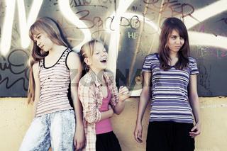 Teenage school girls at the graffiti wall