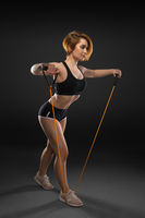 Attractive strong woman exercise with rubber resistance band