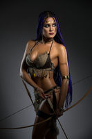 Sexy horsewoman with bow and arrows portrait