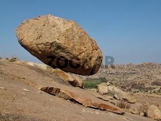 Big balancing granite boulder in Hampi, Karnataka. Unique landscape in India.