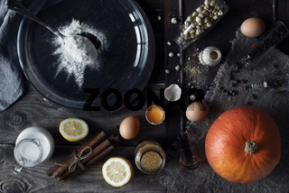 Ingredients for pumpkin pie on the wooden table horizontal