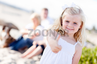 Adorable Little Blonde Girl with Thumbs Up At the Beach