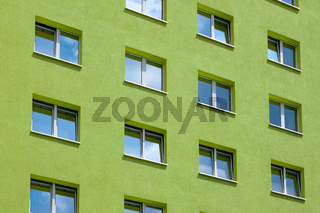 green building exterior , windows on house facade