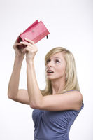 Very surprised adult girl with empty purse