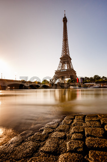 Eiffel Tower and Cobbled Embankment of Seine River at Sunrise, Paris, France