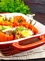 Tomatoes stuffed with rice and meat in brazier